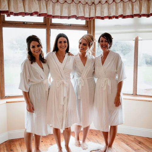 image of the bridesmaids in their white robes