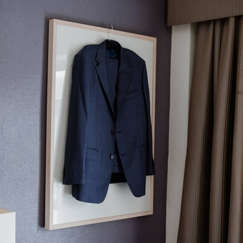 groom's suit hanging from the wall