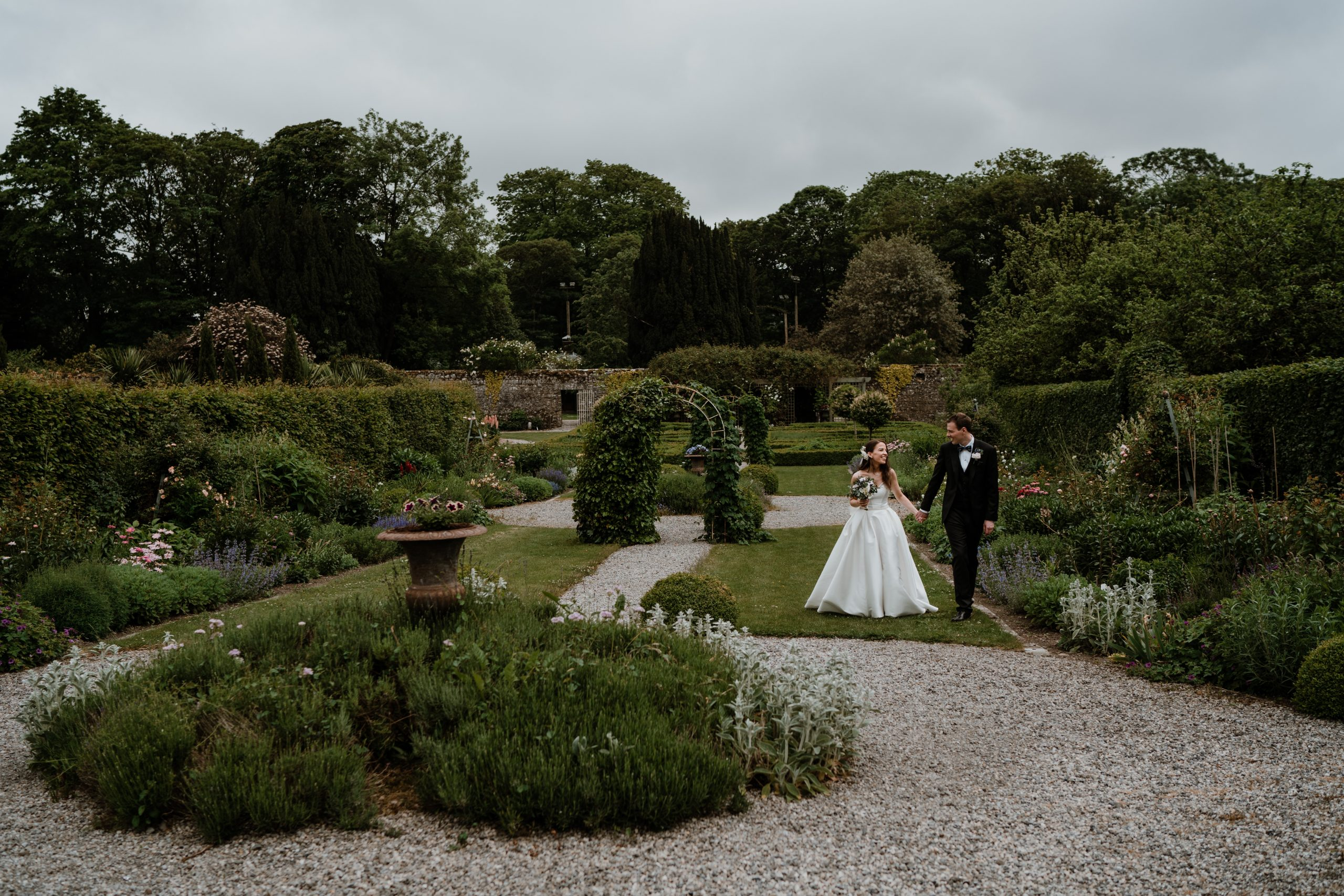 bride and groom walking holding hands castle Durrow